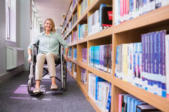 Smiling disabled student in library Royalty Free Stock Photography