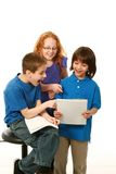 Smiling diverse kids reading royalty free stock photos