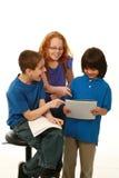 Smiling diverse kids reading stock image