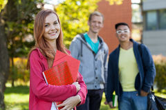 Smiling diverse students. View of smiling diverse students after school Stock Photo
