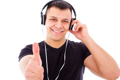 Smiling dj with headphones showing thumbs up Stock Image