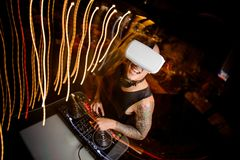 DJ in virtual reality glasses mixes music in club Stock Photography