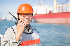 Smiling dock worker holding  radio Royalty Free Stock Photos