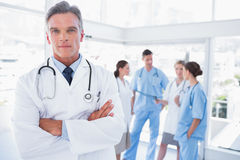 Smiling doctor with arms crossed Royalty Free Stock Image