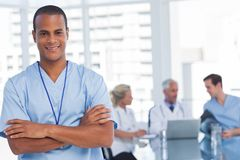 Smiling doctor with arms crossed Stock Photography