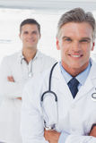 Smiling doctor with arms folded Stock Photo