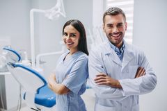 Doctor and assistant with crossed hands royalty free stock photos