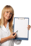 Smiling doctor with blank clipboard Royalty Free Stock Image