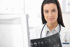 Smiling doctor busy with xray Stock Image
