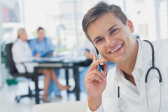 Smiling doctor calling Stock Photo