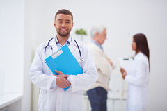 Smiling doctor in clinic Royalty Free Stock Image