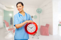 Smiling doctor with clock Royalty Free Stock Photos