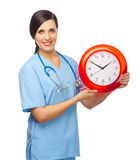 Smiling doctor with clock Stock Images