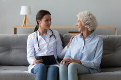 Free Smiling Doctor Consulting Older Woman Patient During Visit At Home Royalty Free Stock Images - 169772619