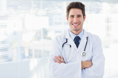 Smiling doctor crossed his arms and looking at camera Stock Image