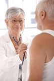 Smiling doctor doing examination Stock Images