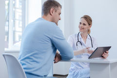 Smiling doctor enjoying appointment in the clinic Royalty Free Stock Photo