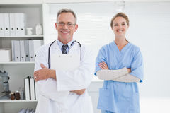 Smiling doctor with fellow co worker Stock Photo