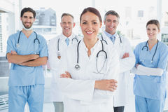Smiling doctor with fellow doctors Royalty Free Stock Images