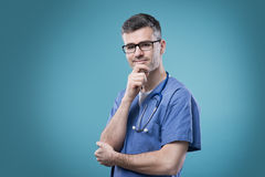Smiling doctor with hand on chin Royalty Free Stock Image