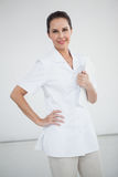 Smiling doctor with hand on hip Royalty Free Stock Photography