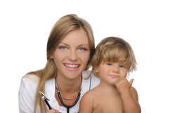 Smiling doctor and happy child Stock Images
