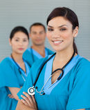 Smiling doctor with her colleagues Stock Image