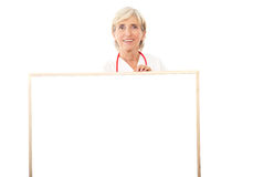 Smiling doctor holding billboard Stock Photos