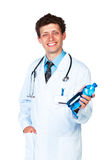 Smiling doctor holding bottle of water on white Stock Photo