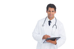 Smiling doctor holding a clipboard and pen Royalty Free Stock Photo
