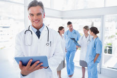 Smiling doctor holding digital tablet Stock Image