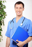 Smiling doctor holding a folder Stock Images