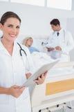 Smiling doctor holding folder Royalty Free Stock Image