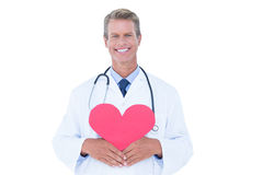 Smiling doctor holding heart card Royalty Free Stock Photography