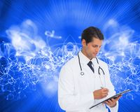 Smiling doctor holding pen and clipboard Royalty Free Stock Images