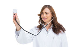 Smiling doctor holding stethoscope royalty free stock images