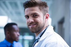 Smiling doctor in the hospital Stock Photos