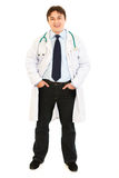 Smiling doctor keeping his hands in pockets Royalty Free Stock Photo