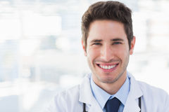 Smiling doctor looking at camera Stock Photos