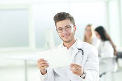 Smiling doctor looking at the digital tablet screen. Photo with copy space royalty free stock images