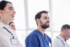 Smiling doctor looking discourse in hospital room Royalty Free Stock Photos
