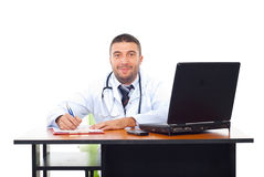 Smiling doctor man in office Stock Photography