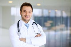 Smiling doctor man. Standing straight in clinic Royalty Free Stock Image