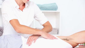 Smiling doctor massaging patients back stock footage