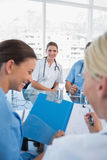 Smiling doctor in a meeting room Stock Photography