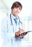 Smiling doctor at office Royalty Free Stock Photo