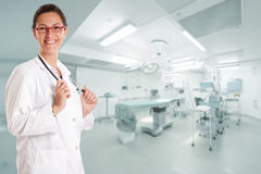 Smiling doctor in operating room Stock Photography