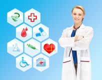 Smiling doctor over medical icons blue background Royalty Free Stock Photos