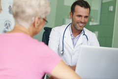 Smiling doctor with patient Stock Photo