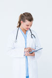 Smiling doctor pointing tablet pc Royalty Free Stock Photography